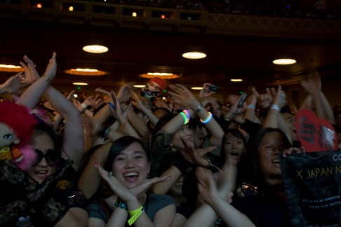 """Toshi: """"We are...?"""" / The crowd: """"X!"""""""