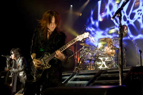 Toshi (vocals), Sugizo (guitar) and Yoshiki (drums) of X Japan
