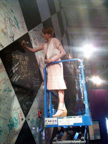 raise it up, raise it up! (Florence signs the Fame Wall at Ex'pression College)