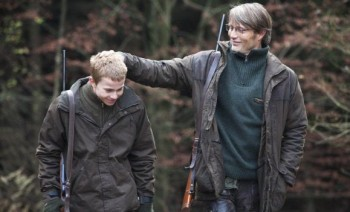 Mads Mikkelsen's Lucas enjoys a moment with his son in The Hunt.