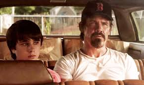 Henry (Gattlin Griffith) is way of his back seat companion (Josh Brolin).