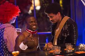 Kevin Hart's Bernie and Michael Ealy's Danny discuss strategy at a Halloween party.