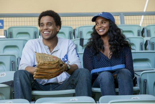 Michael Ealy's Danny watches the game while Joy Bryant's Debbie watches him in About Last Night.