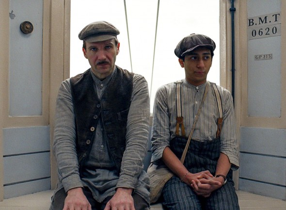Ralph Fiennes as Gustave H. and Tony Revolori as the Lobby Boy Zero contemplate their options in The Grand Budapest Hotel.