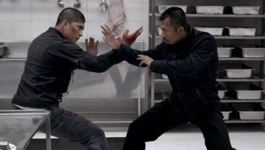 Iko Uwais fights his way through a building ... again.