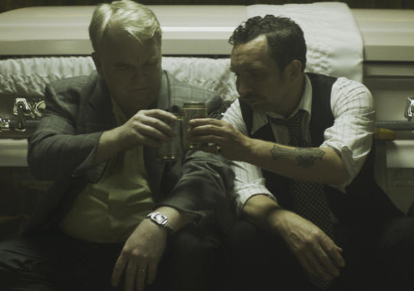 Philip Seymour Hoffman's Mickey and Eddie Marsan's Jack share a drink.