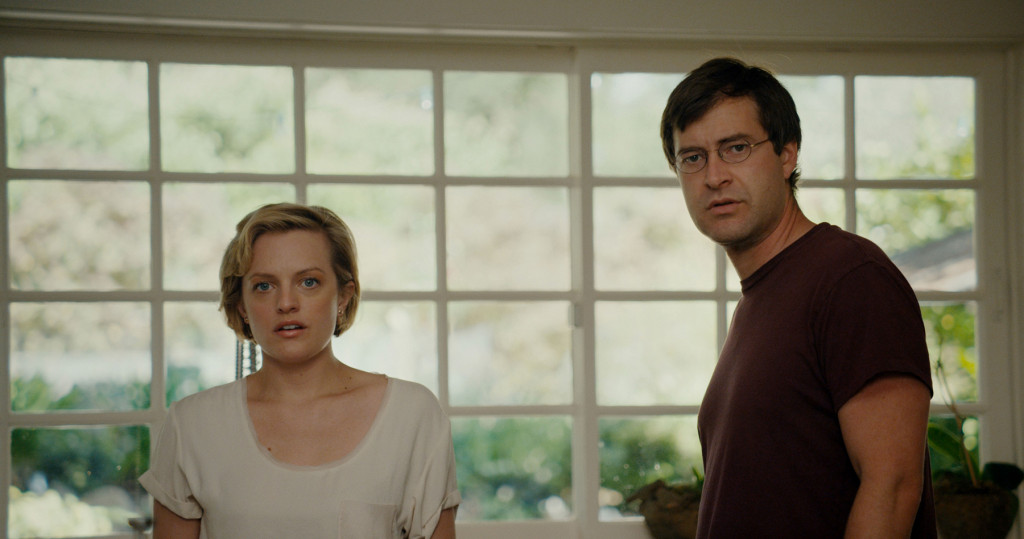 Elisabeth Moss and Mark Duplass stand agape in THE ONE I LOVE