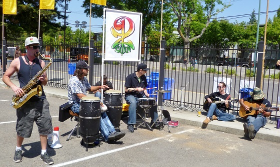 Local reggae band Pion 2 Zion jams just inside the gate.