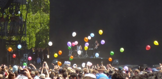 Matt & Kim threw empty balloons to the crowd, who immediately blew them up and batted them around.