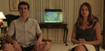 Malcolm (Jonathan Rosen) and Lily (Lola Kirke) wonder... is that all there is?