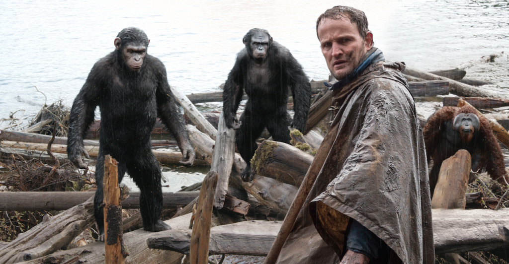 Caesar and Koba stare down Malcolm (Jason Clarke)