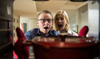 Simon Pegg's Hector and Rosamund Pike's Clara are more than a little excited for some sweet potato stew.
