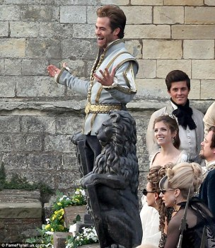 The Prince (Chris Pine) charms the villagers along with Cinderella (Anna Kendrick).