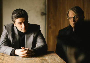 Abel (Oscar Isaac, left) takes a meeting with his lawyer (Albert Brooks).