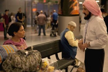 Darwan (Ben Kingsley) meets his new bride Jasleen (Sarita Choudhury) for the first time at the airport.