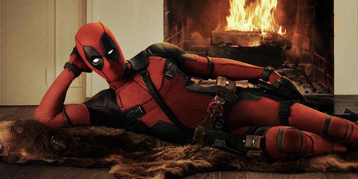 Ryan Reynolds in costume as Deadpool. No feet. Apparently this is important.