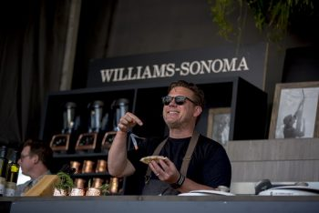 Tyler Florence cheeses for the crowd from the Williams-Sonoma Culinary Stage. (Photo credit: BottleRock Napa Valley / Latitude 38 Entertainment)